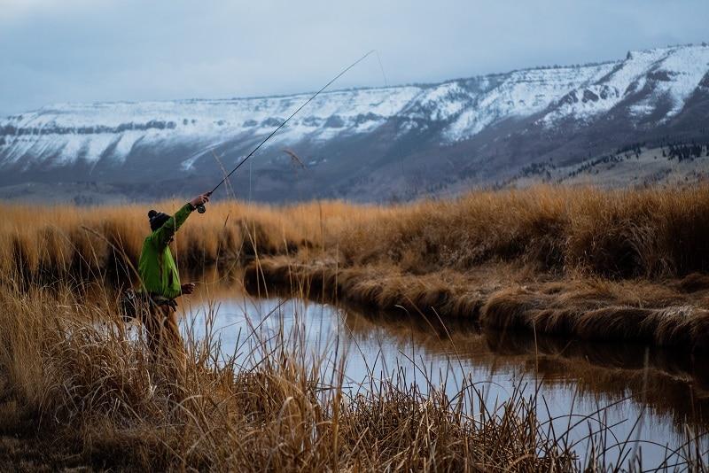 man fishing on travel trip
