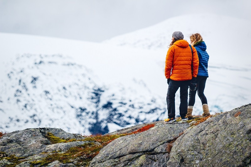 couple hiking in winter mountains