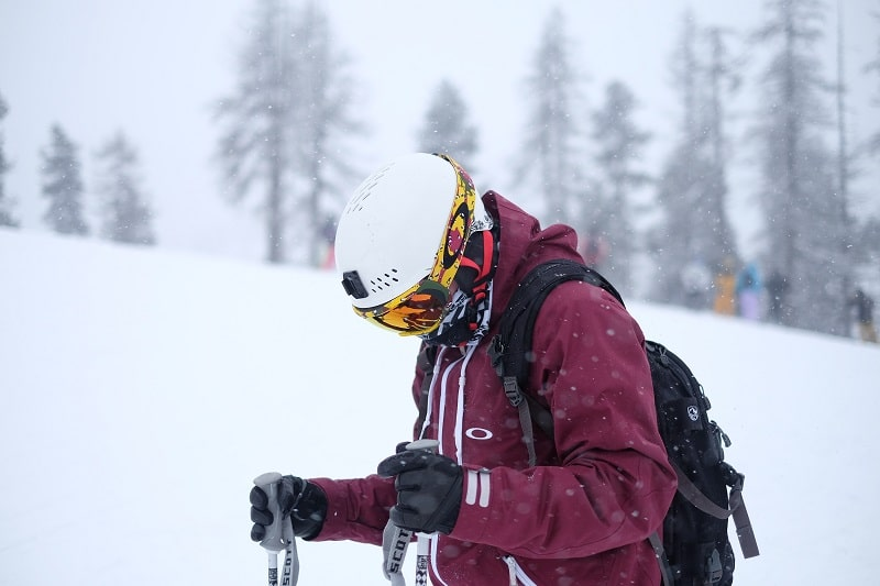 skier wearing heated gloves