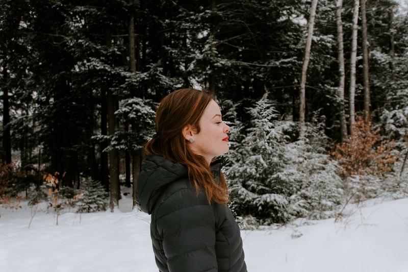 woman wearing winter heated jacket