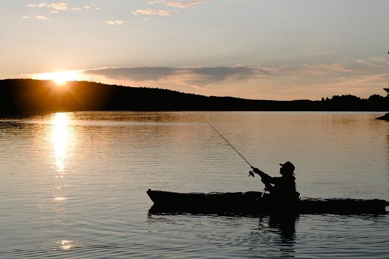 man fishing from kayak