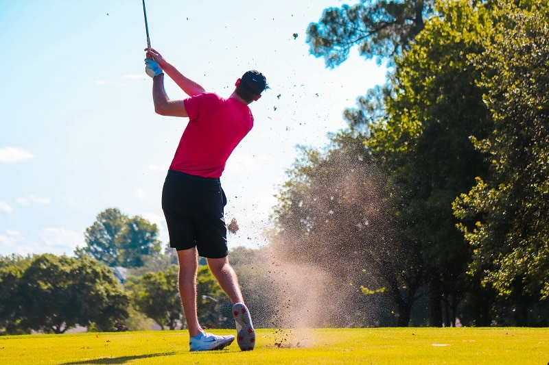 golfer in swing action