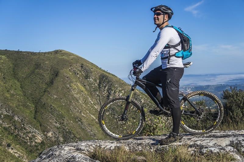 man cycling mountain biking on wilde