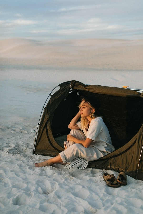 woman tent camping in nature
