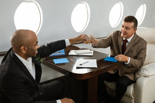 business travelers on private jet