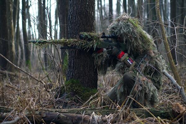 firearm hunter in camouflage