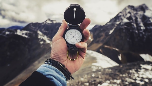 hiking compass to stay safe in the woods