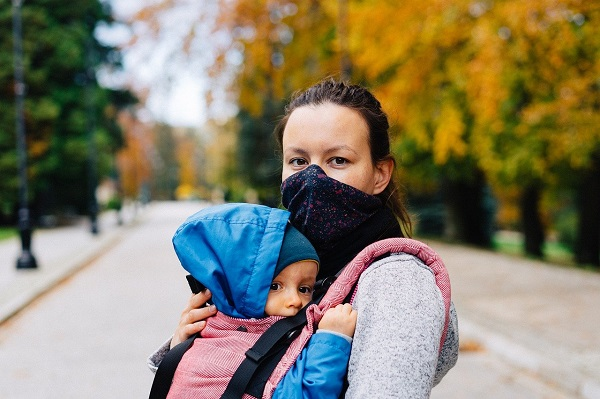 woman wearing mask with child